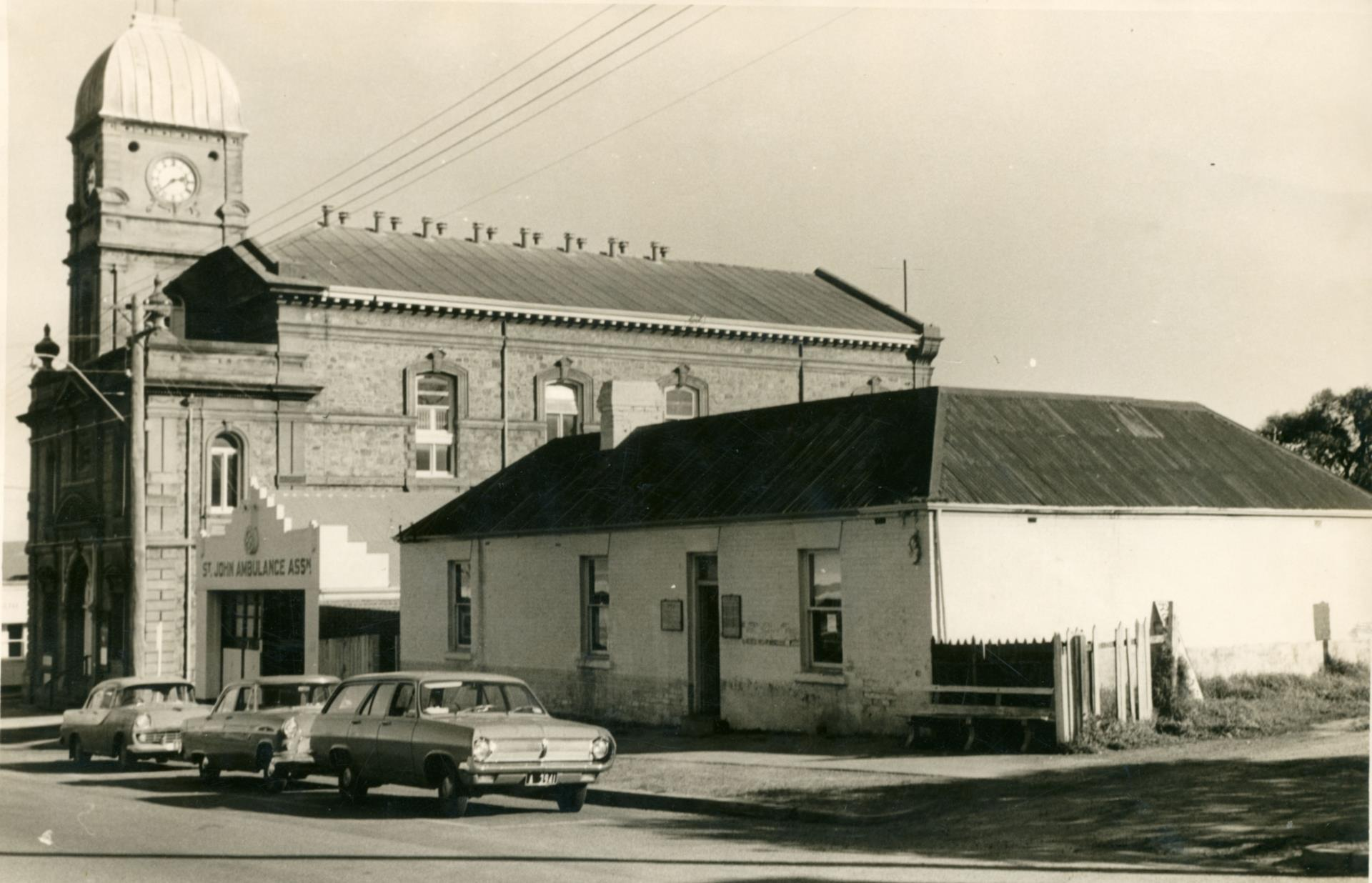 Municipal Library on York Street prior demolition with St Johns Ambulance building and the Town Hall [ca 1966]